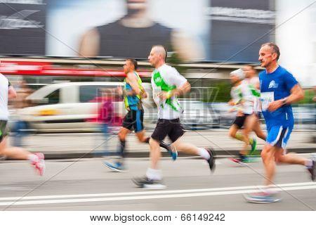 Krakow, Poland - May 18 : Cracovia Marathon. Runners On The City Streets On May 18, 2014 In Krakow,