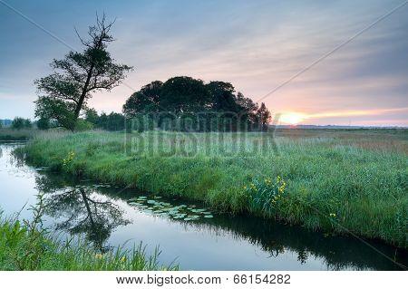 Sunrise Over River In Spring