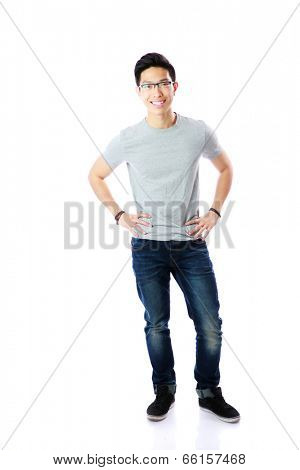 Full-length portrait of a happy man in glasses over white background