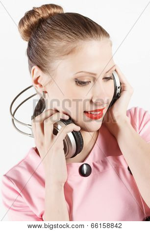 young attractive woman listening to music on headphones