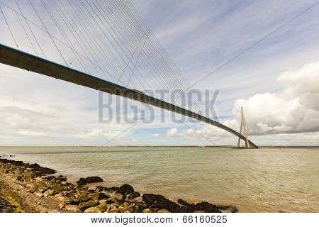 Honfleur, France - May 12, 2014: Pont de Normandie bridge crossing the Seine river between Le Havre and Honfleur, linking the french regions of Haute-Normandie and Basse-Normandie
