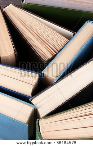 Colorful hardback and paperback books, close-up