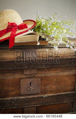 Summer Blue Flowers And Straw Hat On Old Vintage Chest