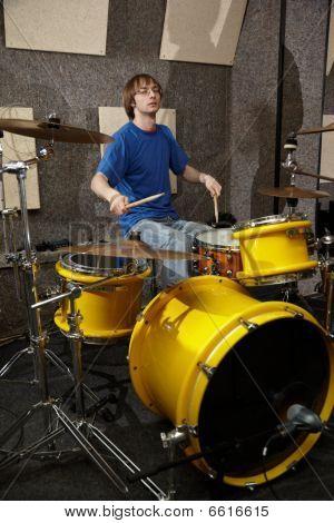 drummer near drumkit