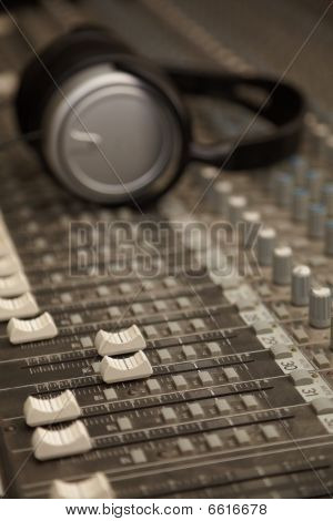 two faders of old dirty sound mixer in focus.
