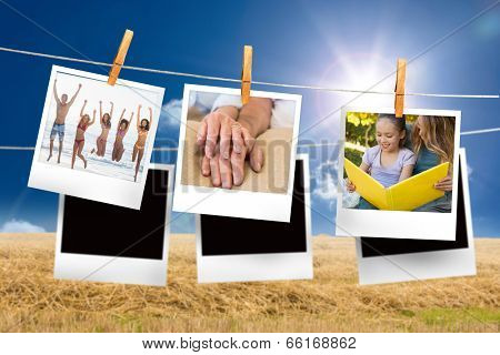 Composite image of instant photos hanging on a line against field and blue sky