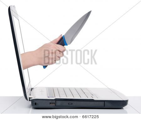 Hand With Knife And Laptop