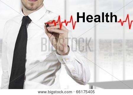 doctor drawing heartbeat line health