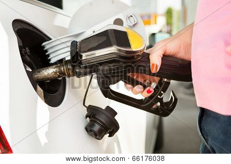 Male Hand Refilling The Car
