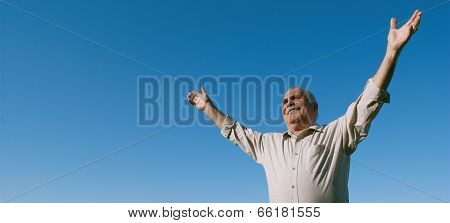 Happy Joyful Elderly Man Embracing The Sun