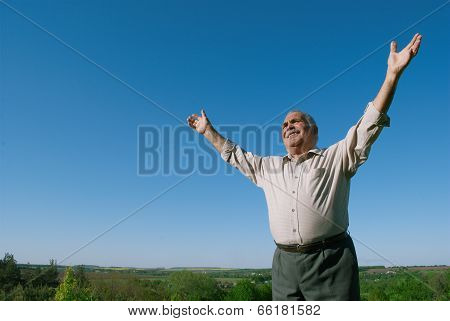 Happy Senior Man Rejoicing In Nature