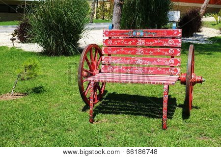 Red Wooden Benches In The Garden