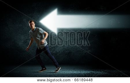 Young funny man ruining away from arrows