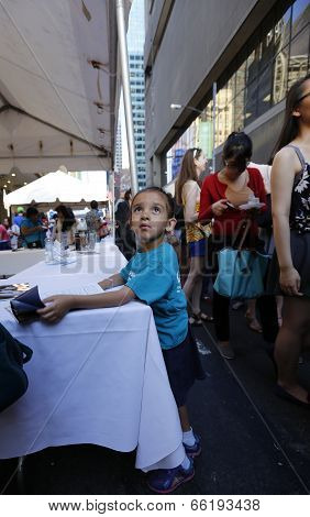Little boy consults menu on 46th Street