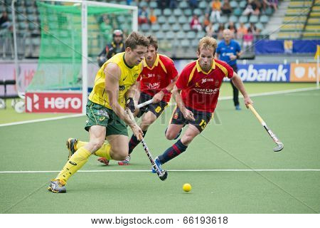THE HAGUE, NETHERLANDS - JUNE 2: Simon Orchard (AUS) tris to find a way through the Spanish Defense (Ruiz and Alegre) during the World Cup Hockey. AUS beats SPA 3-0