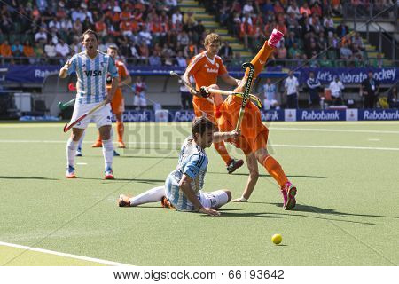 THE HAGUE, NETHERLANDS - JUNE 1: Dutch player de Wijn is tackeld by the Argentinian player Rossi during the Hockey World Cup in the match between The Netherlands and Argentina (men). NED beats ARG 3-0
