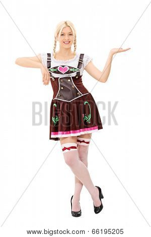 Full length portrait of a Bavarian woman holding an imaginary tray isolated on white background