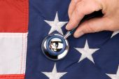 foto of inference  - A doctor examines an american flag with a stethoscope - JPG