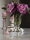 stock photo of pompous  - bouquet of peonies on the table tea break - JPG