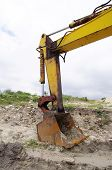 picture of backhoe  - Backhoe excavator in sand quarry in cloudy day