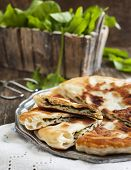foto of sorrel  - Homemade Flatbread With Sorrel and fresh sorrel on table - JPG