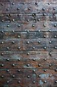 picture of slit  - The  Old wooden surface with metal knobs - JPG