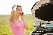 picture of breakdown  - Stressed Young Woman Breakdown With Car Calling For Service On Mobilephone - JPG