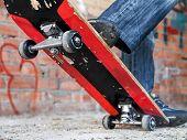 stock photo of skate board  - boy moves up on a skate board - JPG