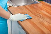 image of apron  - Closeup Of Young Woman Wearing Apron Cleaning Kitchen Worktop