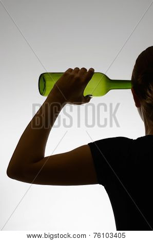 Alcoholic Woman With A Bottle