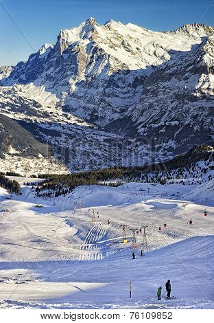 People On Ski  And Snowboards Near Cable Railway On Winter Sport Resort In Swiss Alps