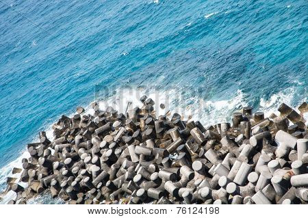 Man Made Stones In Sea Wall