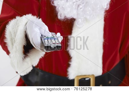 Close Up Of Santa Claus Holding Television Remote Control
