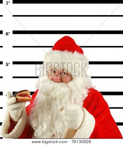 BUSTED. Santa Claus is arrested and his MUG SHOT taken at the Police Station. Santa was a Bad Bad boy.