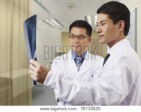 Doctors Looking At X-ray Film
