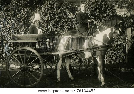 RUSSIA - CIRCA  1900s:  Vintage photo shows man and woman in a horse cart.