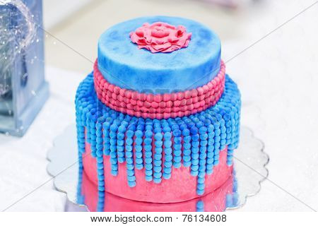 Wedding Cake In Blue And Red Or Pink. With Elegant Pearls