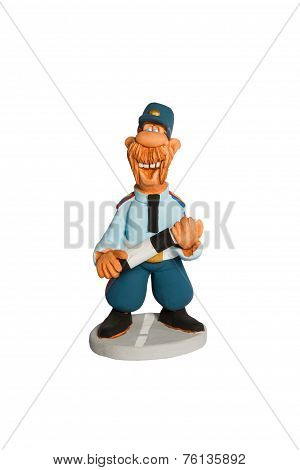 Statuette Of Policeman With A Stick On The Road