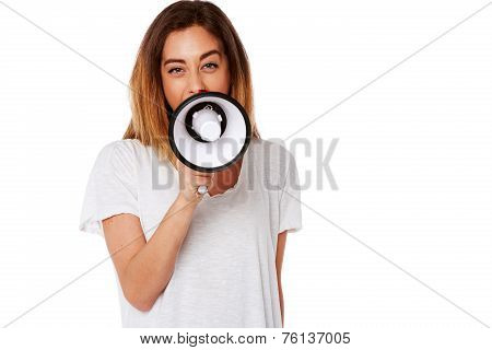 Young Woman Shouting Into A Megaphone
