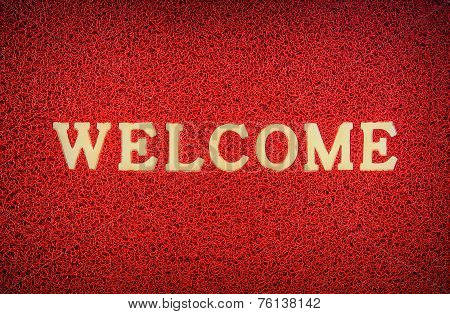 Texture Of Red Doormat With Welcome Text