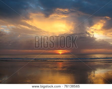 Expanse of the sea against the sunset sky.