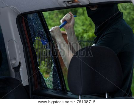 Burglar With Crowbar Breaking Car Window