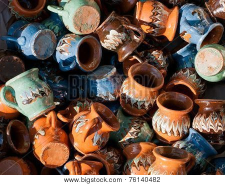 Romanian traditional pottery handcrafted mugs at a souvenir shop. Romanian traditional pottery