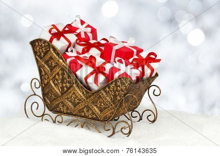 Christmas sleigh filled gifts
