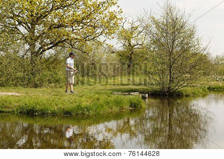 Fishermen At A Fishing Pond