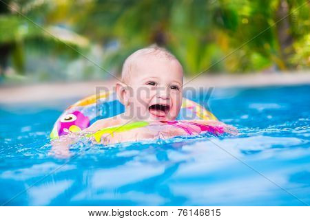 Sweet Baby In A Swimming Pool