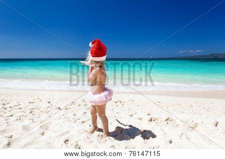 ?ute Little Girl In Santa Hat On Beach