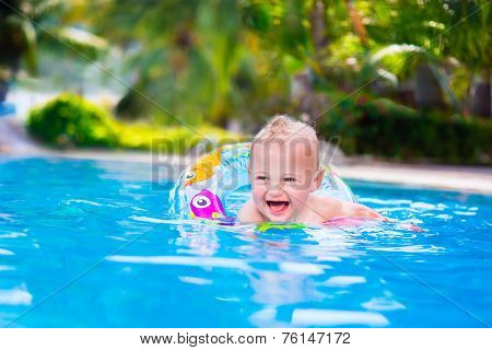 Funny Baby In A Swimming Pool