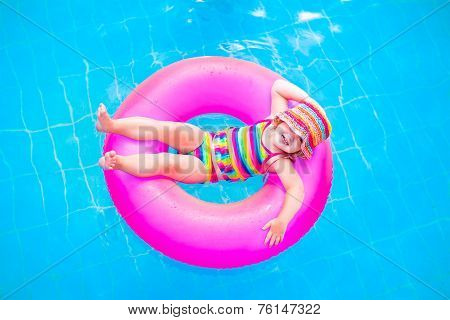 Little Cute Girl In Swimming Pool