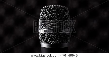 Wireless Microphone Closeup On Foam Acoustic Background